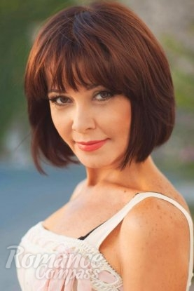 Ukrainian girl Victoria,53 years old with brown eyes and dark brown hair.