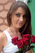 Ukrainian girl Snezhana,19 years old with green eyes and dark brown hair.
