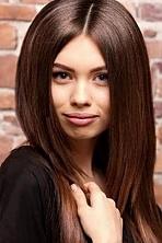 Ukrainian girl Tatiana,23 years old with brown eyes and light brown hair.