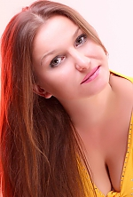 Ukrainian girl Anna,34 years old with grey eyes and light brown hair.