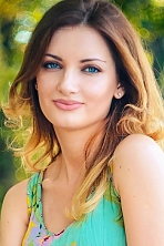 Ukrainian girl Natalia,25 years old with blue eyes and dark brown hair.