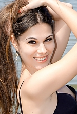 Ukrainian girl Anna,27 years old with brown eyes and dark brown hair.