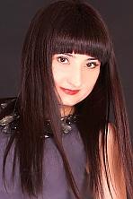 Ukrainian girl Tatiana,40 years old with brown eyes and dark brown hair.
