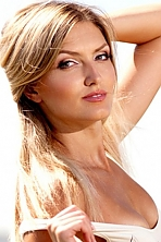 Ukrainian girl Mariia,25 years old with blue eyes and light brown hair.
