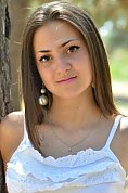 Ukrainian girl Anna,22 years old with brown eyes and dark brown hair.