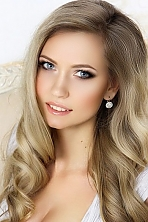 Ukrainian girl Elena,22 years old with blue eyes and blonde hair.