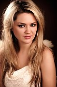 Ukrainian girl Oksana,32 years old with brown eyes and blonde hair.