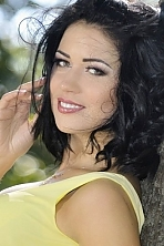 Ukrainian girl Viktoriya,31 years old with green eyes and black hair.