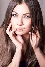 Ukrainian girl Katya,20 years old with green eyes and dark brown hair.