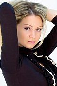 Ukrainian girl Julia,34 years old with green eyes and blonde hair.