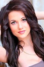 Ukrainian girl Maria,26 years old with brown eyes and dark brown hair.