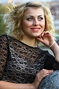 Ukrainian girl Anna,25 years old with blue eyes and blonde hair.