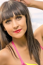 Ukrainian girl Marina ,28 years old with brown eyes and dark brown hair.