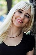 Ukrainian girl Nadia,43 years old with brown eyes and blonde hair.