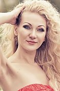 Ukrainian girl Olga,33 years old with blue eyes and blonde hair.