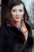 Ukrainian girl Viktoria,32 years old with green eyes and dark brown hair.