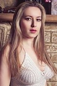 Ukrainian girl Olga,30 years old with brown eyes and light brown hair.