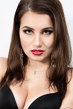 Ukrainian girl Anna,23 years old with grey eyes and dark brown hair.