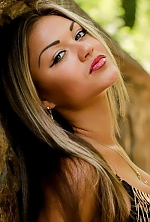 Ukrainian girl Anna,23 years old with grey eyes and blonde hair.