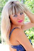Ukrainian girl Oksana,29 years old with grey eyes and blonde hair.