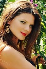 Ukrainian girl Victoria,34 years old with grey eyes and dark brown hair.
