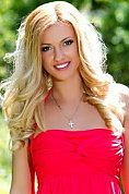 Ukrainian girl Irina,22 years old with grey eyes and blonde hair.