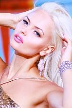 Ukrainian girl Svetlana,35 years old with grey eyes and blonde hair.