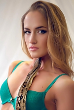 Ukrainian girl Marina,24 years old with green eyes and light brown hair.