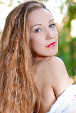 Ukrainian girl Yuliana,25 years old with blue eyes and light brown hair.