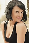 Ukrainian girl Nataliya,40 years old with green eyes and black hair.