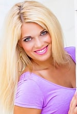 Ukrainian girl Elena,26 years old with green eyes and blonde hair.
