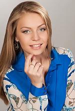 Ukrainian girl Alina,24 years old with grey eyes and blonde hair.