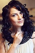 Ukrainian girl Elena,25 years old with blue eyes and black hair.