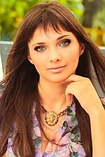 Ukrainian girl Margarita,20 years old with green eyes and dark brown hair.