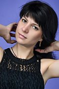 Ukrainian girl Oksana,37 years old with brown eyes and black hair.