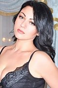 Ukrainian girl Julia,30 years old with green eyes and black hair.