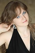 Ukrainian girl Anna,28 years old with blue eyes and light brown hair.