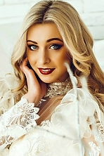 Ukrainian girl Anastasya,22 years old with blue eyes and blonde hair.