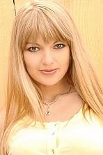 Ukrainian girl Anastasia,31 years old with green eyes and light brown hair.