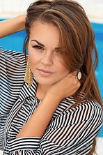 Ukrainian girl Alyona,23 years old with brown eyes and light brown hair.
