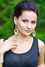 Ukrainian girl Kate,21 years old with brown eyes and dark brown hair.