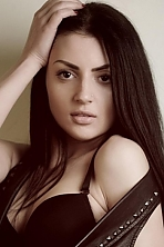 Ukrainian girl Zorianna,23 years old with brown eyes and black hair.