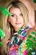 Ukrainian girl Anna,30 years old with grey eyes and blonde hair.