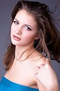Ukrainian girl Olga,22 years old with green eyes and dark brown hair.