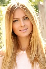Ukrainian girl Lyna,27 years old with brown eyes and light brown hair.