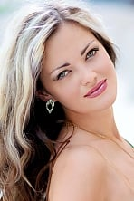 Ukrainian girl Elena,39 years old with green eyes and blonde hair.
