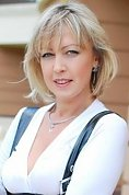 Ukrainian girl Zhanna,41 years old with grey eyes and blonde hair.