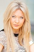 Ukrainian girl Tatiana,34 years old with grey eyes and blonde hair.