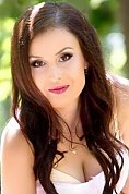 Ukrainian girl Oksana,23 years old with brown eyes and dark brown hair.