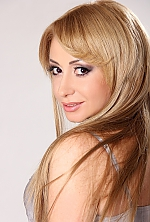 Ukrainian girl Angela,40 years old with brown eyes and light brown hair.